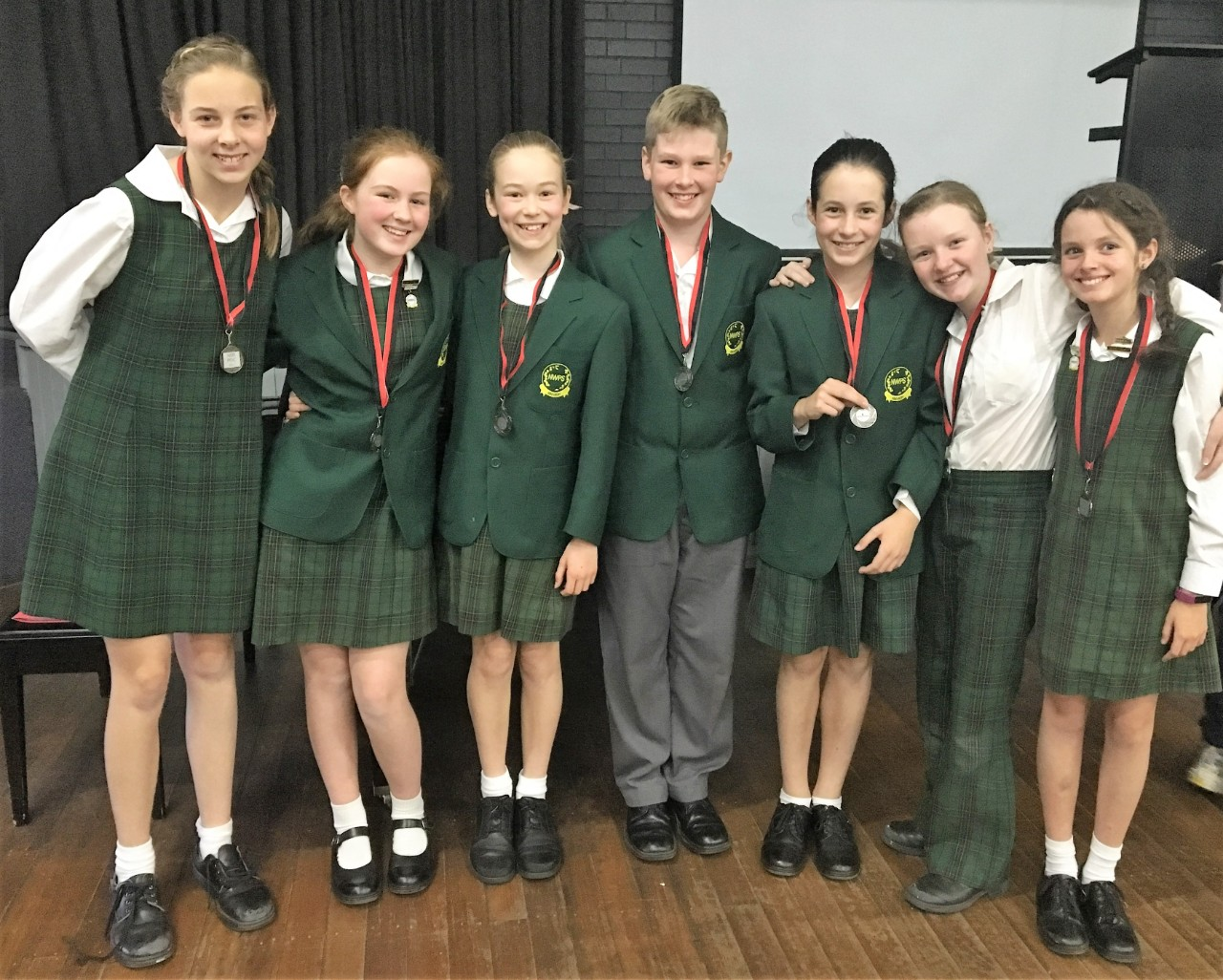 Students from Year 5 are cheering for earning the medal at Debate competition
