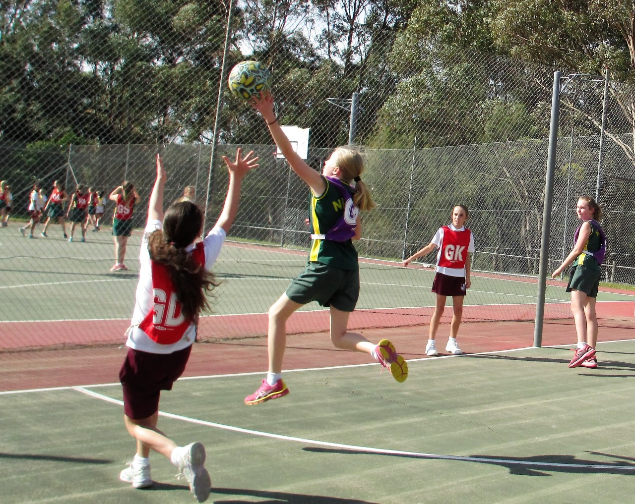 Girls playing basket ball at NSW primary schools sports association